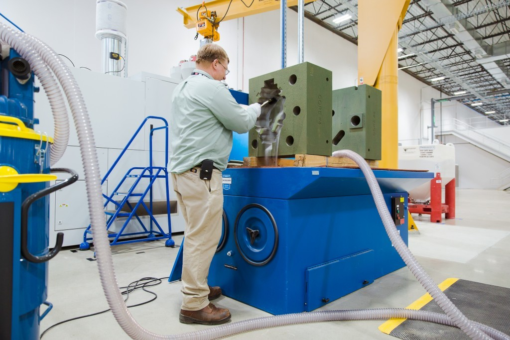 """""""We are making the Jell-O mold for the jelly,"""" says Dave Miller, the engineer working with the sand binder jetting machine (Photo: GE Reports)"""
